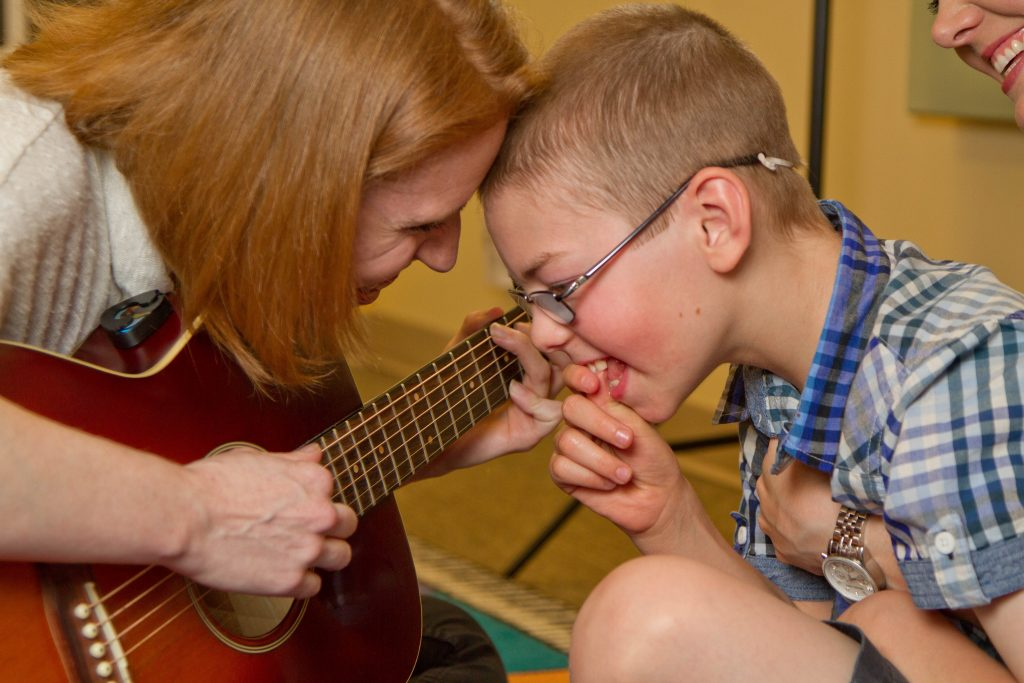 Michelle and N connecting during a music therapy session.